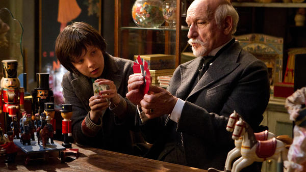 Hugo Cabret (Asa Butterfield) is a 12-year-old orphan whose life changes after he encounters Georges Melies (Ben Kingsley) in his magical toy store in a Paris train station.