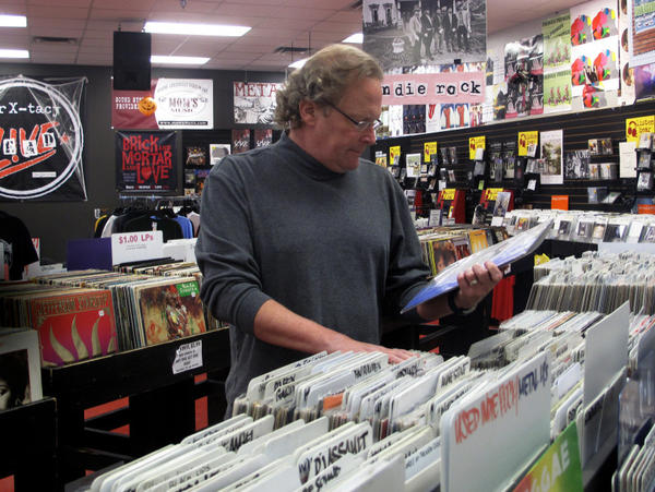 Timmons browses the racks of his now-closed business. The record store will have a final clearance sale on Nov. 29.