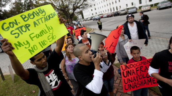 Protesters march outside the Alabama Capitol during a demonstration against the state's immigration law in Montgomery, Ala., on Nov. 15.