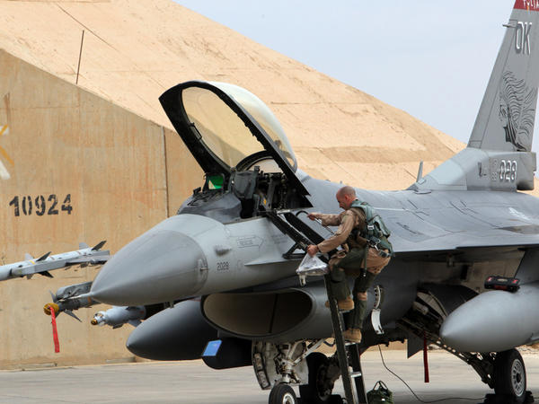 One of the reasons for the shift to unmanned aircraft has been fighter jet budget cuts. Here, a pilot climbs into a U.S. F-16 at Al Asad Air Base in Iraq on Nov. 1.