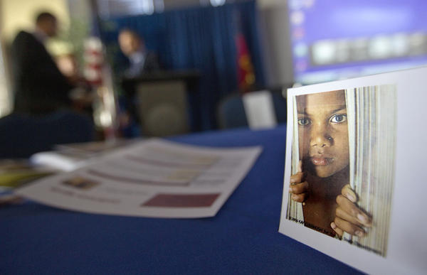 A placard of a child sits on a table during a conference Oct. 31 on human sex trafficking in Atlanta. The Georgia Department of Education estimates that about 5,000 girls in the state are at risk for trafficking each year.