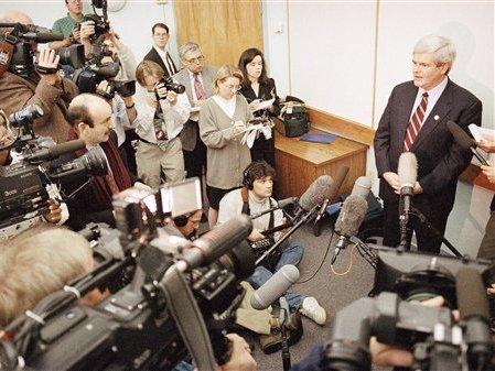 Then-House Speaker Newt Gingrich holds court at Reinhardt College in Waleska, Ga., March 11, 1995, after teaching his final class at the school. The 10-week course was criticized as a partisan forum for Gingrich, and became part of a House ethics investigation against him.