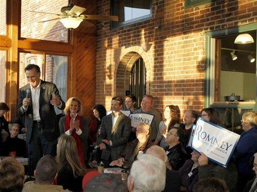 Mitt Romney speaks during a campaign stop Wednesday at Elly's Tea and Coffee in Muscatine, Iowa.