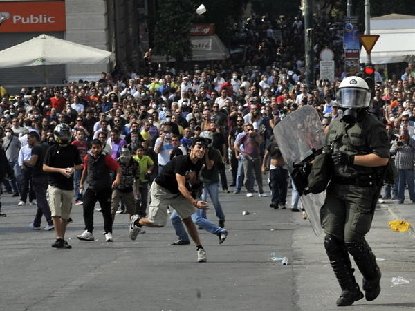 Anti-riot police clash with Greek demonstrators in Athens in October during a protest against deeper austerity cuts, as the debt crisis in Greece and the rest of Europe intensified this year.