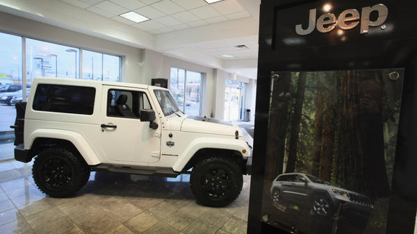 A Jeep Wrangler is seen at a dealership in Chicago. Powered by a newly designed fleet of vehicles, the brand saw a sharp rise in sales in 2011.