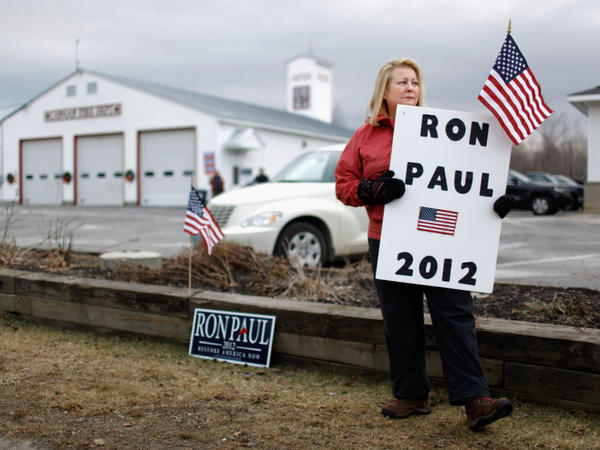 Susan Gayhart stations herself outside the polls at a fire station in Canaan, N.H., on the morning of the primary.