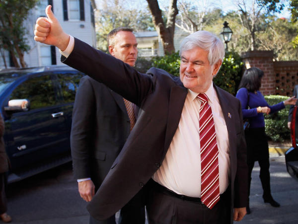 Newt Gingrich arrives for a GOP presidential candidate <em></em>forum Saturday in South Carolina. Gingrich had to be reminded of the rules not to mention rivals by name, but was still able to continue criticism of Mitt Romney.