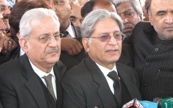 The prime minister's legal counsel Aitzaz Ahsan (center) outside the Supreme Court, following the appearance of Prime Minister Yousef Reza Gilani before a seven member bench. Gilani faces contempt charges for his government's refusal to re-open a corruption case against President Asif Ali Zardari.
