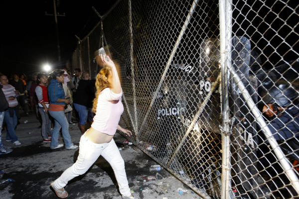 In northern Mexico, relatives of inmates at Apodaca prison outside Monterrey attack the security fence, Feb. 21. Violence at the prison on Feb. 19 left 48 inmates dead; the transfer of three prisoners to another criminal center prompted more violence two days later.