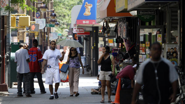 Pedestrians walk along a section of Jamaica Avenue in Woodhaven, Queens, New York. The neighborhood is part of an area targeted for congressional redistricting, but the process is still dragging on as the state's primary draws near.