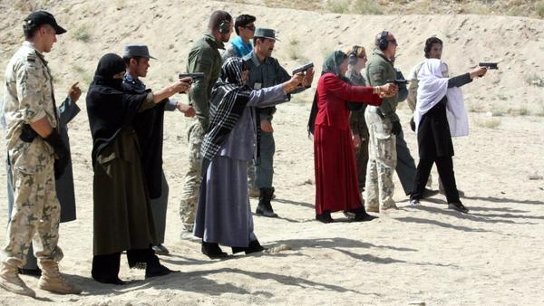 Afghan female police officers are trained by Afghan police and NATO soldiers in eastern Afghanistan's Ghazni province on Sept. 12. In the culturally conservative country, women serving in the security forces say they face systemic sexual coercion and even rape by male colleagues.