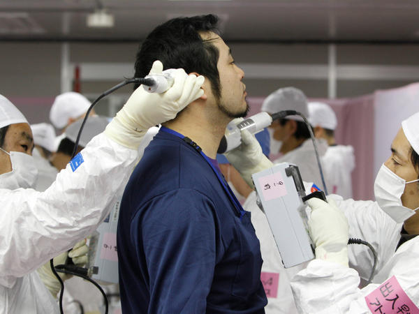 A worker is given a radiation screening as he enters the emergency operation center at Tokyo Electric Power Co.'s tsunami-crippled Fukushima Dai-ichi nuclear power plant on Feb. 20.