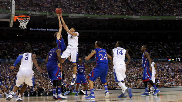 Anthony Davis of the Kentucky Wildcats puts up a shot over Jeff Withey of the Kansas Jayhawks in the NCAA Division I men's basketball final Monday night at the Mercedes-Benz Superdome in New Orleans.