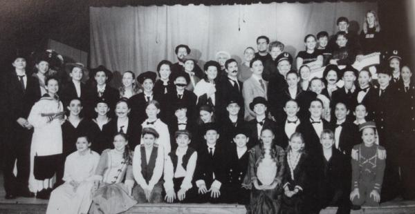 "The cast and crew of <em>Titanic</em>, as pictured in my 2001-2002 yearbook. I'm standing in the third row back on the right side, in front of the ""captain."""