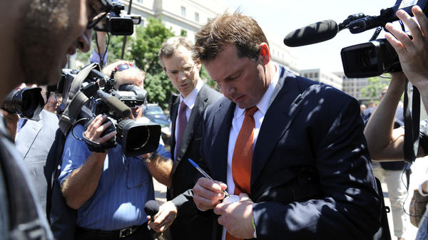 Former Major League Baseball pitcher Roger Clemens stops to sign a baseball as he leaves the federal courthouse in Washington, D.C., on July 14, 2011, after a judge declared a mistrial in his perjury trial.