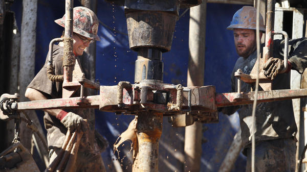 """Oil field workers drill into the Gypsum Hills near Medicine Lodge, Kan. Hydraulic fracturing, or """"fracking,"""" to coax out oil and gas has led to a natural gas boom that the U.S. market is having trouble absorbing."""