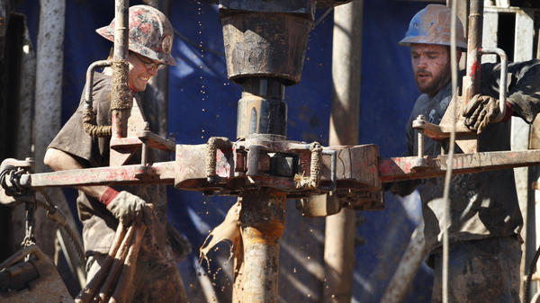 Oil field workers drill into the Gypsum Hills near Medicine Lodge, Kan., on Feb. 21. The Environmental Protection Agency announced new rules Wednesday to control the problem of air pollution coming from wells being drilled by the booming oil and natural gas drilling industry.