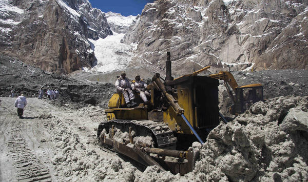 Pakistani army soldiers work Wednesday at the site of a massive avalanche that buried 140 people, including 129 soldiers, April 7 at the Siachen glacier. Pakistan's army chief called for the peaceful resolution of the Himalayan glacier dispute with rival nuclear power India.