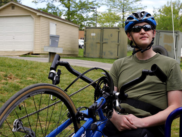 "Patrick Brown, 23, lost most of both legs when he was hit by an IED on a bomb-clearing patrol in Afghanistan in 2010. Learning how to ride a bike again, he says, ""is a chance to start over."""