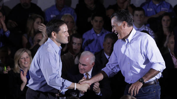 Republican presidential candidate Mitt Romney shakes hands with Sen. Marco Rubio, R-Fla., during a town hall-style meeting in Aston, Pa., on Monday.