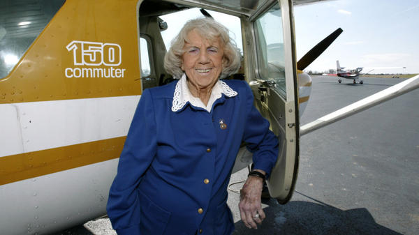"""Evelyn """"Mama Bird"""" Johnson poses by at the airport she managed in Morristown, Tenn., in this 2005 file photo. Johnson, who began flying in 1944, died Thursday."""