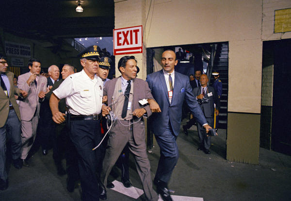 Wallace took a sock in the jaw while covering the tumultuous 1968 Democratic convention in Chicago, where he was hustled off the floor in the aftermath of a row between delegates and security officers.