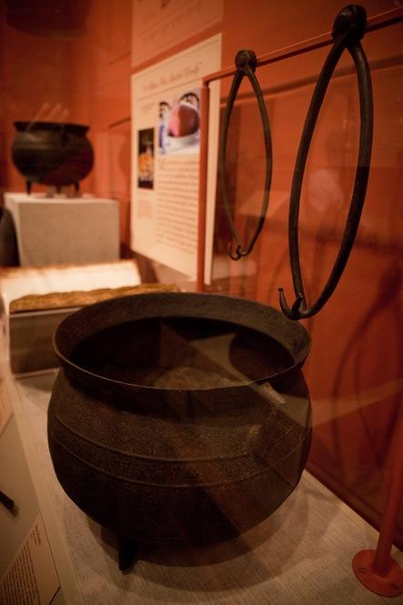 These large iron pots from the Mount Vernon kitchen were probably used to cook large cuts of meat like ham, beef and fowl. The metal hooks were used to pull the giant pots out of the fire.