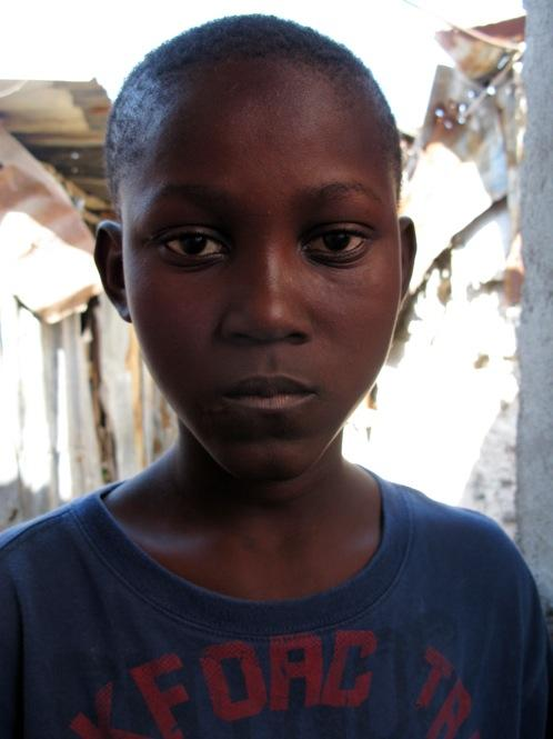 Jude Auseva, 10, was in the hospital for five days last fall being treated for cholera.