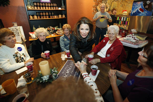 U.S. Rep. Michele Bachmann, R-Minn., greets local residents during a campaign stop at the Merry Bees coffee shop, Monday, Dec. 19, 2011, in Hampton, Iowa.