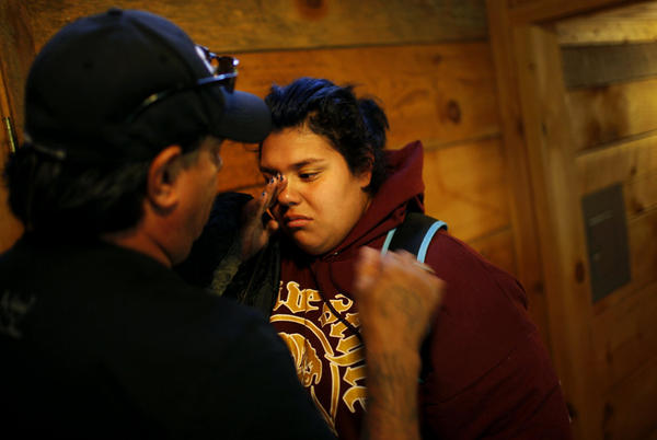 Jade Tapia, 14, cries as she says goodbye to her father just after arriving on the Wellspring campus in August. If students make enough progress in the first eight weeks, they earn the right to go home for the weekend or to go out to eat with their visiting families.