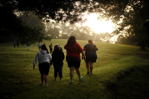 Savannah Davis (second from right) walks with her friends to the cafeteria. In the five years of its existence, Wellspring has earned a reputation for teaching overweight children to prefer healthful food and exercise.