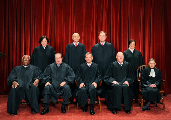 Thomas (front row, left) sits with the other justices for the annual Supreme Court photo on Oct. 8, 2010.