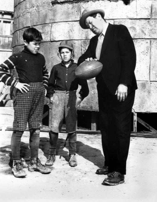 Thorpe (right) gives some passing tips to his sons Phil (left) and Bill on a movie set in Los Angeles in 1940. Desperate to make ends meet after his professional sports career, Thorpe set his sights on Hollywood, where he was often cast in movies as an American Indian.