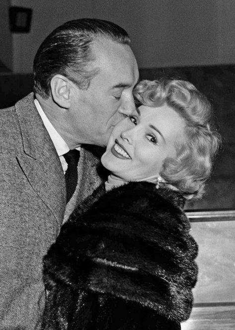 Gabor gets a kiss from her husband, actor George Sanders, at the Rome Ciampino Airport on Feb. 16, 1953.