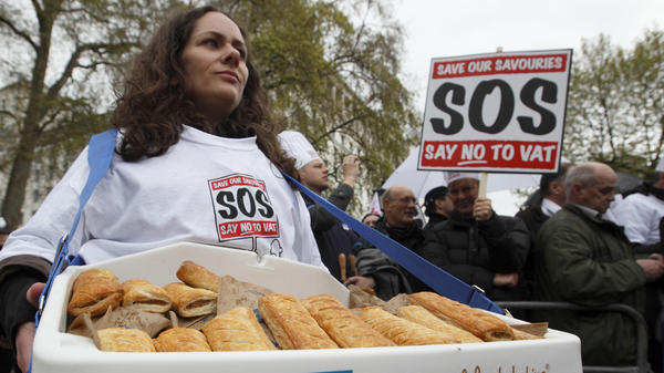 """Protesters gather outside Downing Street in London to deliver a petition against the so-called """"pasty tax,"""" a government bid to levy 20 percent tax on hot takeaway food."""