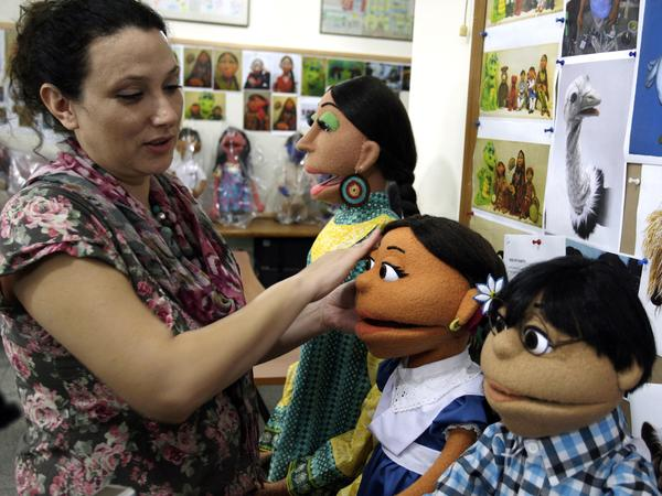 A Pakistani artist in Lahore touches up puppets from Pakistan's <em>Sesame Street</em>. The U.S. Embassy in Pakistan says it has terminated funding for a $20 million project to develop a local version of <em>Sesame Street</em> amid reports of corruption.