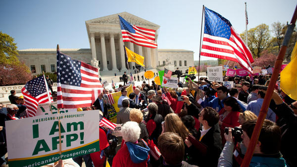 Demonstrators both for and against the health care law turned out on the steps of the Supreme Court on March 27, the second day of oral arguments before the court.