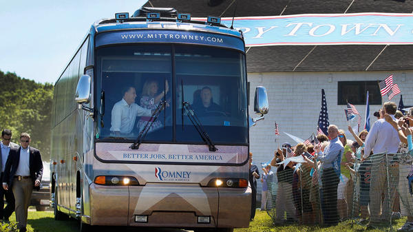 Republican presidential candidate Mitt Romney and his wife, Ann, wave from a campaign bus on Friday at Scamman Farm in Stratham, N.H.