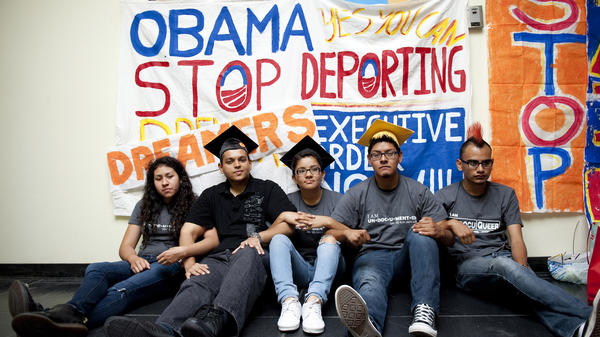 Myisha Areloano, Adrian James, Jahel Campos, David Vuenrostro and Antonio Cabrera camp outside President Obama's campaign headquarters in Culver City, Calif., on Friday to protest his immigration policies.