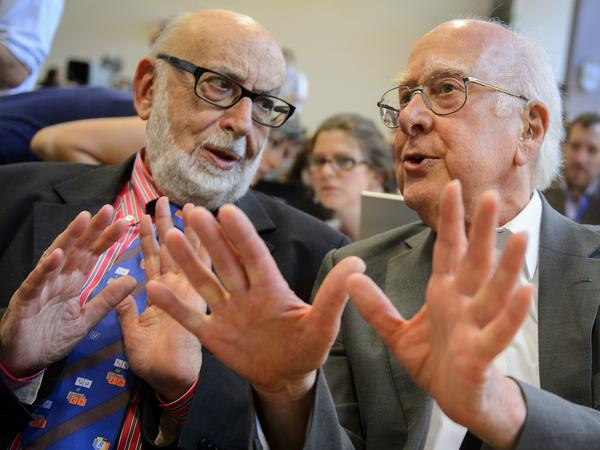 British physicist Peter Higgs (right), who proposed the Higgs boson in the 1960s, speaks with Belgium physicist Francois Englert at Wednesday's event.