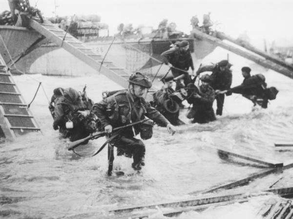 Allied troops invade Juno Beach on D-Day. Ben MacIntyre's latest book, <em>Double Cross</em>, recounts the grand deception beforehand that helped make the invasion a success.