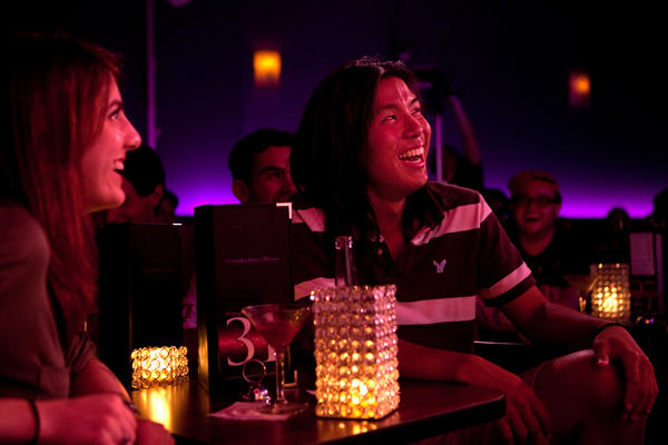Megan Lutz, left, and Justin Chun react to Lynch's standup routine. When we laugh at a joke, Lynch hypothesizes, we are often revealing our unconscious attitudes.