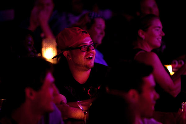 Bruno Fava laughs at a joke at the Metropolitan Room. Lynch finds there's a connection between self-deception and laughter.