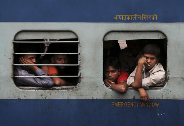 Passengers wait for train service to resume after a power outage in New Delhi. Indian officials say they are rapidly restoring power, but it's unclear how soon the situation will be back to normal.