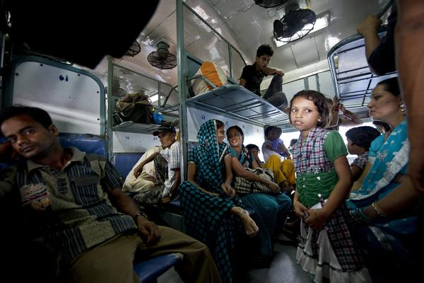 Passengers wait on a train during the power outage in New Delhi on Tuesday. The crisis affected an estimated 670 million people.