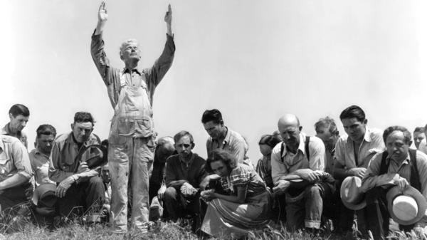 Henry Hall prays to the heavens in 1934's <em>Our Daily Bread</em>. King Vidor's film about a farmers collective living through a drought was made during one of the country's most catastrophic dry spells.