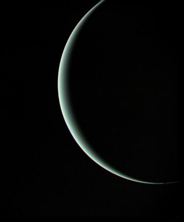 After the Voyager craft surveyed Jupiter and Saturn, NASA extended their mission and sent Voyager 2 on to Uranus and Neptune. Voyager 1 kept traveling outward. This image of Uranus was captured by Voyager 2 in 1986, when it was about 600,000 miles from the planet. Uranus' pale blue-green color is a result of methane in the atmosphere.