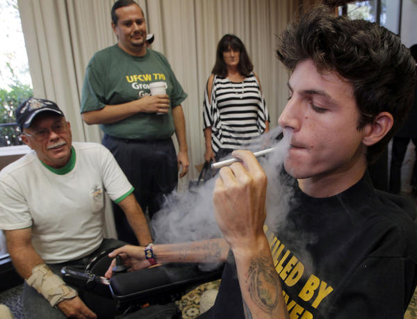 Medical cannabis patient Michael Oliveri smokes marijuana during a news conference in Universal City, Calif., last week. Medical marijuana advocates say they have enough signatures to place a referendum before voters that would overturn a ban on pot clinics in Los Angeles.