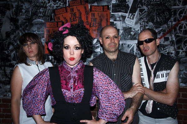 "The Corin Tucker Band, from left: Sarah Lund, Corin Tucker, Seth Lorinczi and Mike Clark — dressed up as X-Ray Spex in the video for ""Neskowin."""