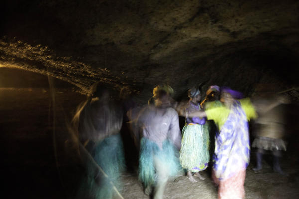 This sacred cave housed the Batwa king and was the main venue for celebrations. A choir in the darkness sings a song of sadness about how the Batwa were driven from the forest, and how much they miss it.